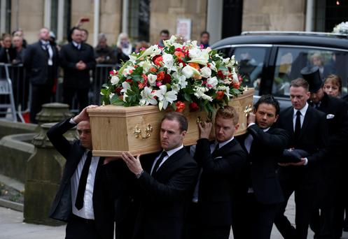 Cast members (left to right) Jack P Shepherd, Alan Halsall, Mikey North and Ryan Thomas carry the coffin of Coronation Street creator and writer Tony Warren into Manchester Cathedral for his funeral