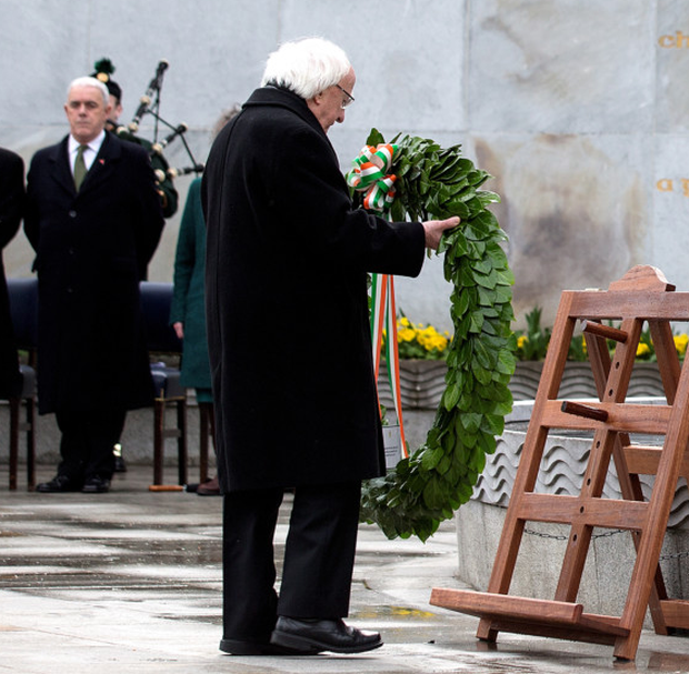 President Michael D Higgins and relatives of some of the Rising combatants at the wreath-laying ceremony in the Stone Breakers Yard at Kilmainham Gaol