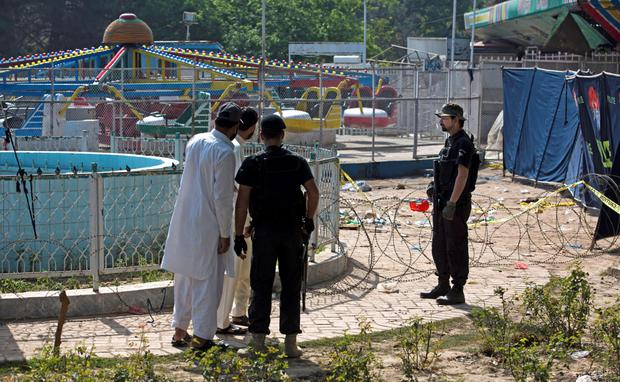 Pakistani police cordon off the bomb site at the amusement park in Lahore, Pakistan. Photo: AP