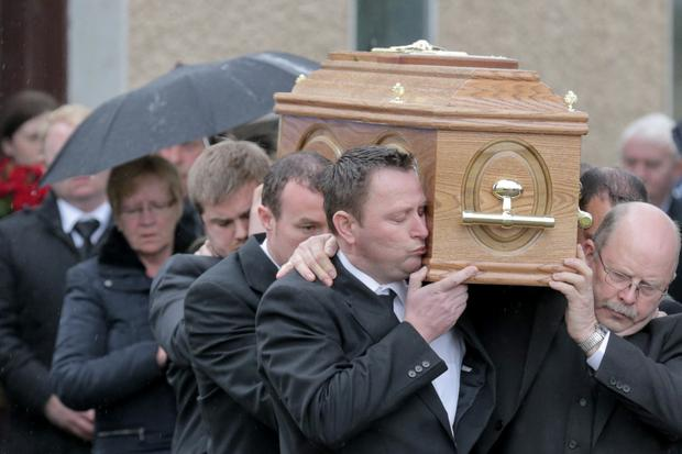Bernard Fitzpatrick kisses his wife's coffin (Pic: Keith Heneghan)