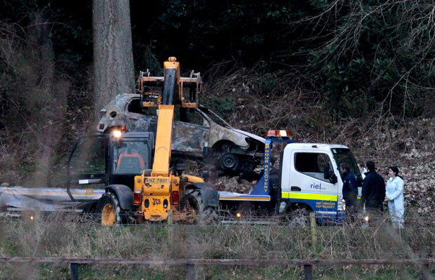 The burnt-out car in which the bodies of Redmond and Burnett were found is removed from Ravensdale Forest (Frank McGrath)
