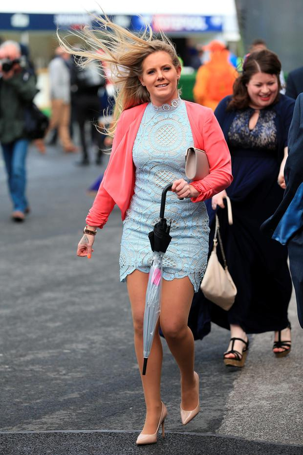 A female racegoer arrives during the Grand Opening Day of the Crabbie's Grand National Festival at Aintree Racecourse, Liverpool. Picture date: Thursday April 7, 2016. Photo: Mike Egerton/PA Wire