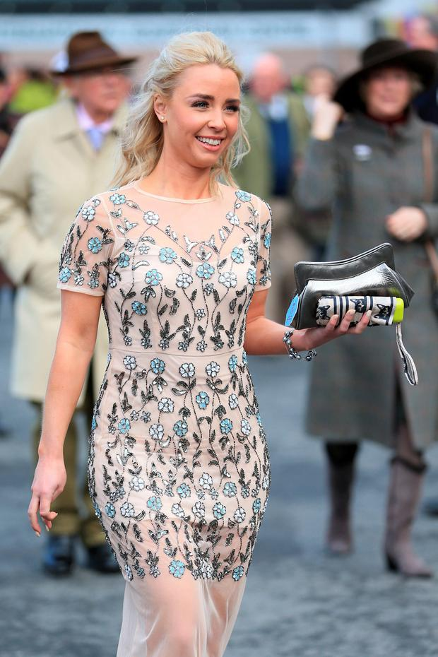 A female racegoer arrives during the Grand Opening Day of the Crabbie's Grand National Festival at Aintree Racecourse, Liverpool. PPicture date: Thursday April 7, 2016. Photo: Mike Egerton/PA Wire