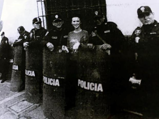 Michaella posing with cops in Peru