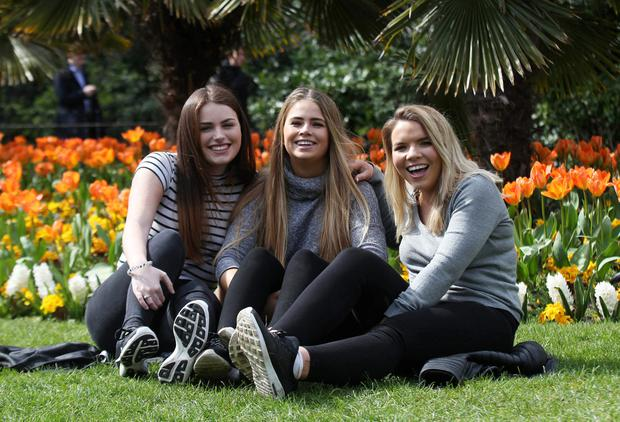Sarah Egan, Hannah Egan and Laura-Anne Caulfield enjoying the good weather in Stephen's Green (Collins Dublin)