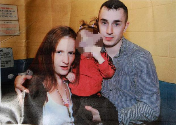 Innocent gangland victim Martin O'Rourke with his partner Angeline and one of their children