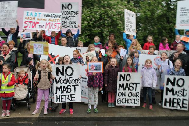 Children and parents protest against planned phone mast