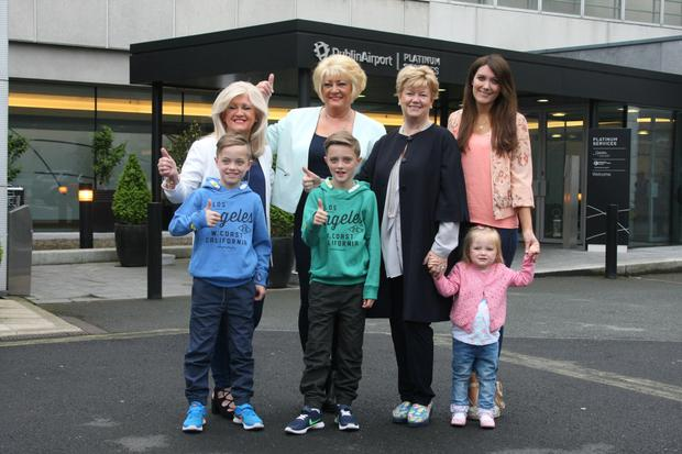 Georgina Byrne (right) with twins Rocco and Jay and daughter Gia and (from left) Nicky's mum Yvonne, aunt Marie and mother-in-law Miriam Ahern at Dublin Airport en route to Stockholm