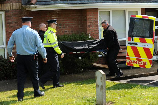 A body is removed from the house to an ambulance (Picture: Caroline Quinn)