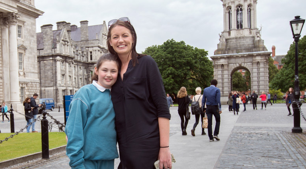 Erica Fleming at Trinity College with her daughter Emily (9)