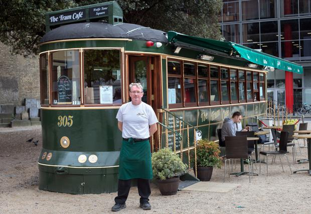 Owner Dave Fitzpatrick in front of the Tram Cafe on Dublin's Wolfe Tone Square