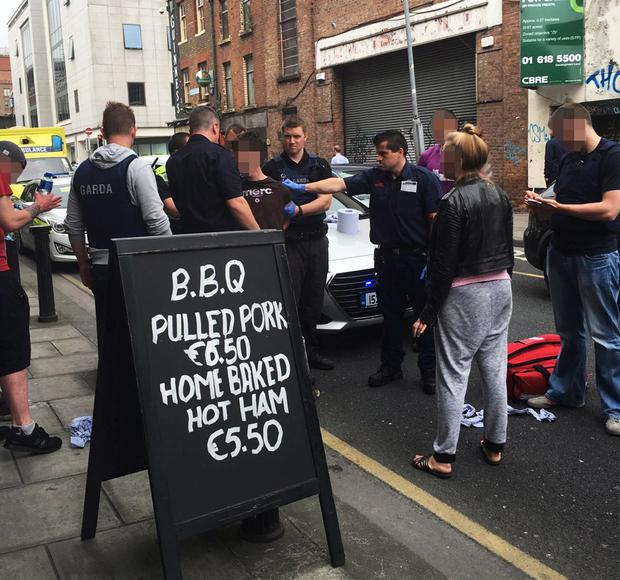 The scenes outside Ned's pub on Townsend Street as armed gardai deal with the brawl's aftermath