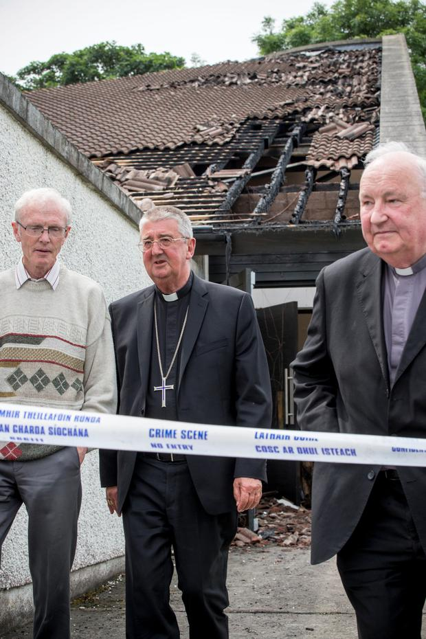 Archbishop Diarmuid Martin (centre) surveys the fire damage Picture: Mark Condren