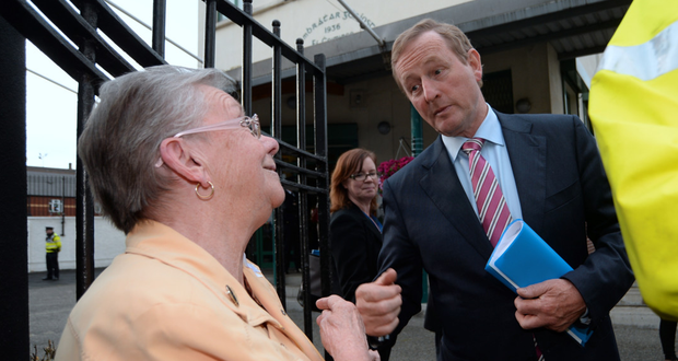 Taoiseach Enda Kenny greets local Kathleen Pickett on arrival Picture: Caroline Quinn
