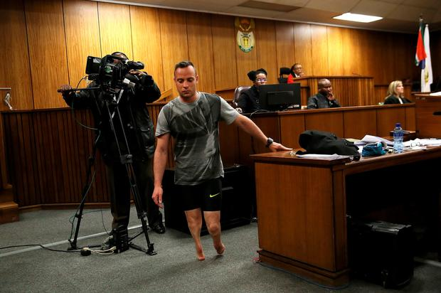 Pistorius walks in court at his sentencing hearing for the murder of girlfriend Reeva Steenkamp Picture: AFP/Getty