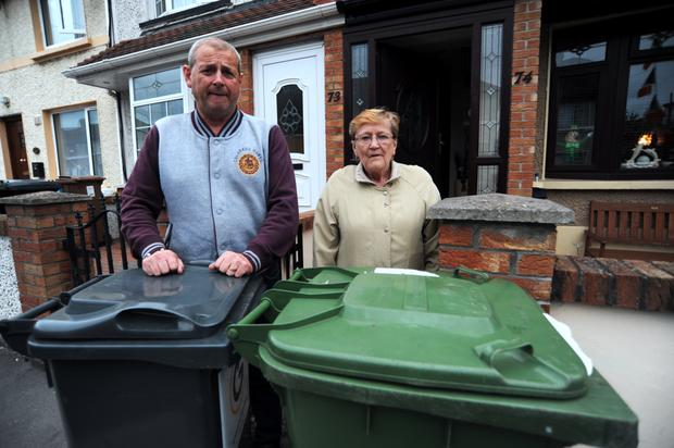 Joe Lyons and his mother-in-law Carmel Lynch with their wheelie bins Picture: Caroline Quinn