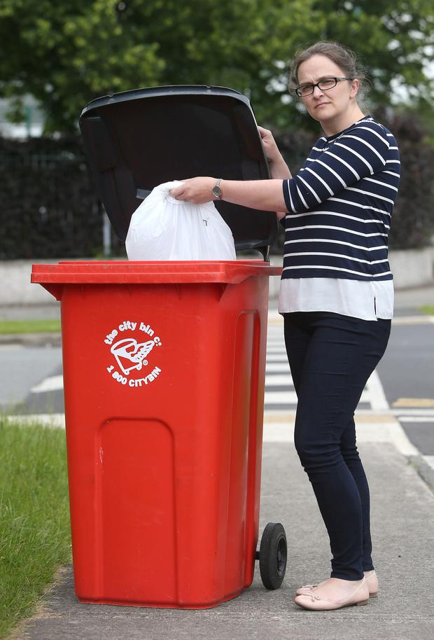 Colette Gallagher puts out the rubbish Picture: INM