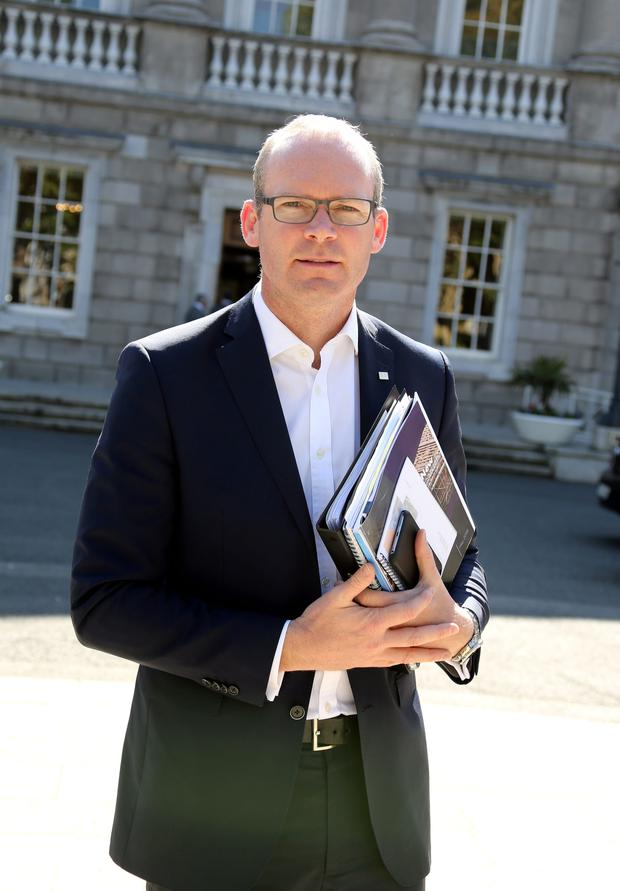 Environment Minister Simon Coveney will meet with firms about the rising costs