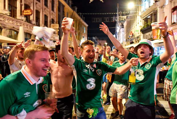 Fans celebrate late into the night after Robbie Brady sent Ireland through to the knock-out stages (SPORTSFILE)