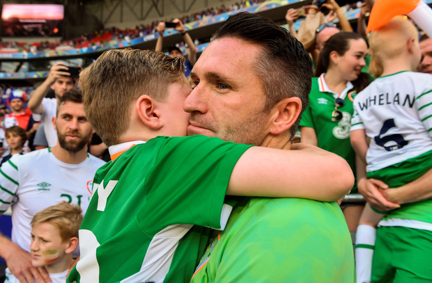 Robbie Keane shares a moment with his son after the match. Photo: David Maher/Sportsfile