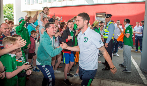Robbie Brady is greeted by delighted fans as the team arrive at Dublin Airport Photo: PA