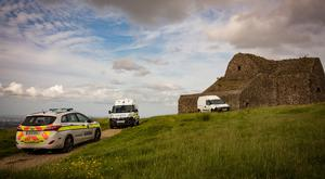 Gardai at the ruin of the Hell Fire Club in the Dublin mountains after three campers were attacked Picture: Arthur Carron