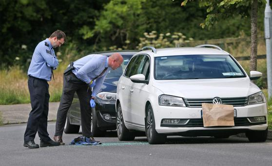 Gardai examine the scene of a shooting this morning in Dun Emer Place, in Lusk, Co. Dublin