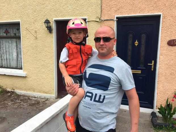 Lubos Kocik with his son Gordon (9) who was woken by the gunfire which shattered the glass in the door of a nearby house