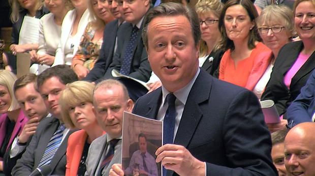 Cameron with a picture of Larry, the Downing St cat