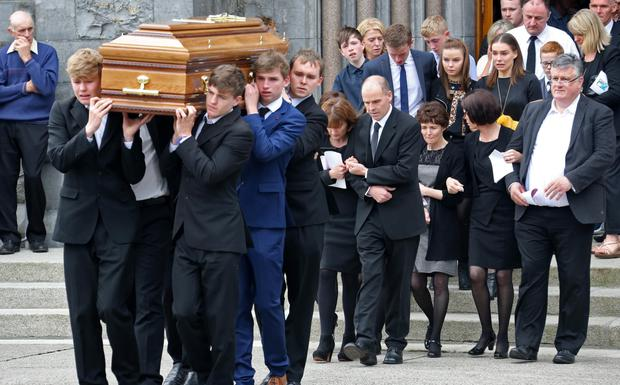 John and Eimear Lawlor, parents of Ciara follow her remains as they are taken from the church
