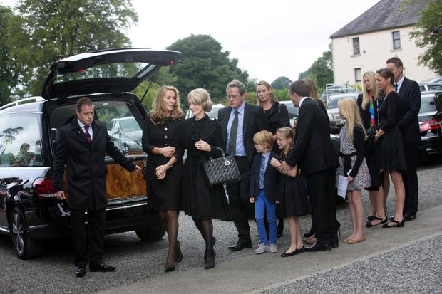 Collette, widow of Joe Hayes, former managing director of Independent Newspapers, is comforted by her daughter Danielle