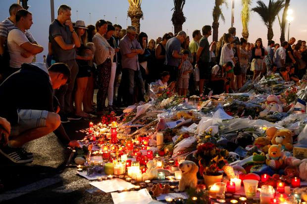 Distraught mourners leave flowers for the terror attack victims