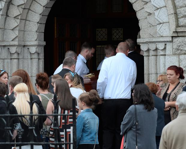 The coffin of Paul Curran arriving at St Agnes's Church Picture: Caroline Quinn