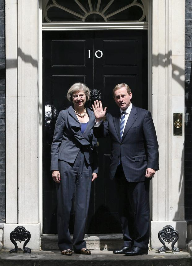 An Taoiseach Enda Kenny with new British PM Theresa May Picture: Reuters