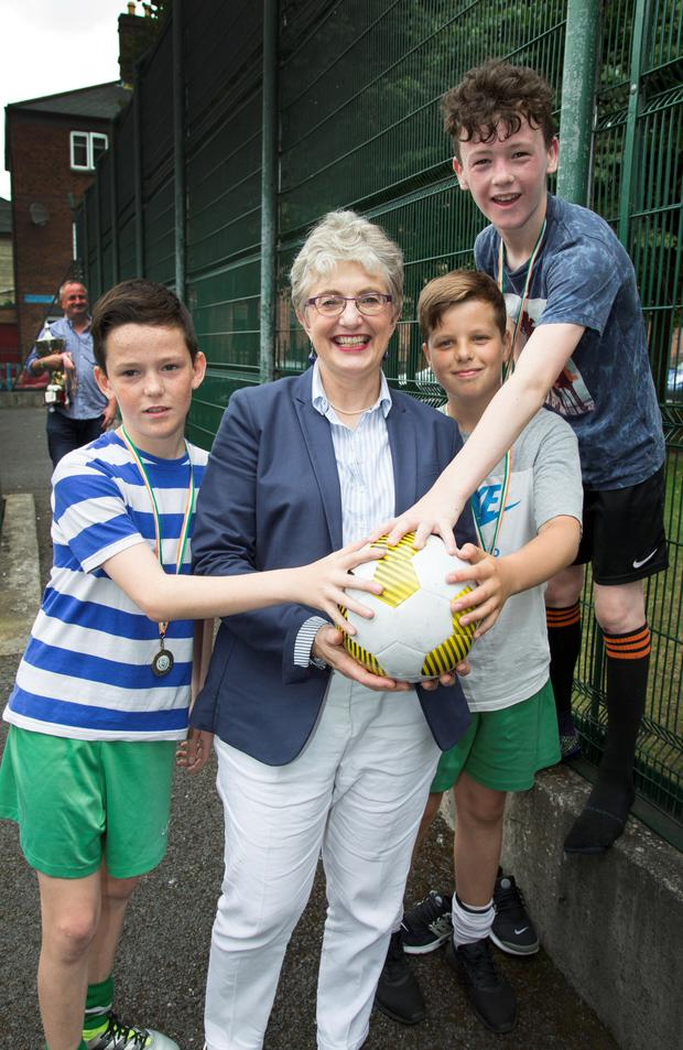 Minister Katherine Zappone with Jamie Murtagh, Jonathan Bewley and Lewis Brophy of Sheriff Street Youth Club Photo: Colin O'Riordan