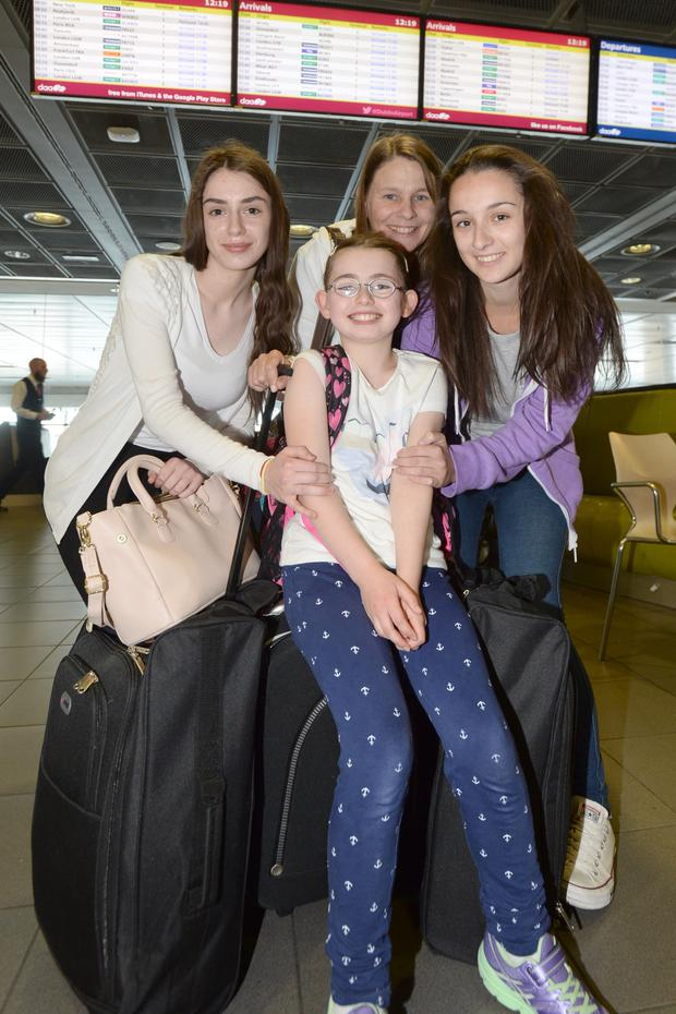 Denise (9), Rachel (17), Lavinia (21) and Mary Ruane from Galway heading off to Lanzorate at Dublin Airport.