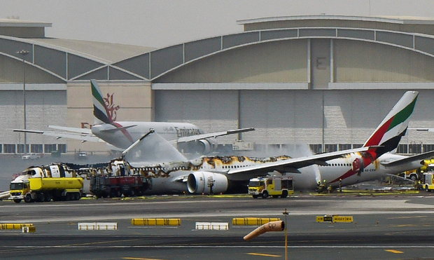 The smouldering wreckage of the Emirates plane at Dubai airport Photo: AFP/Getty Images