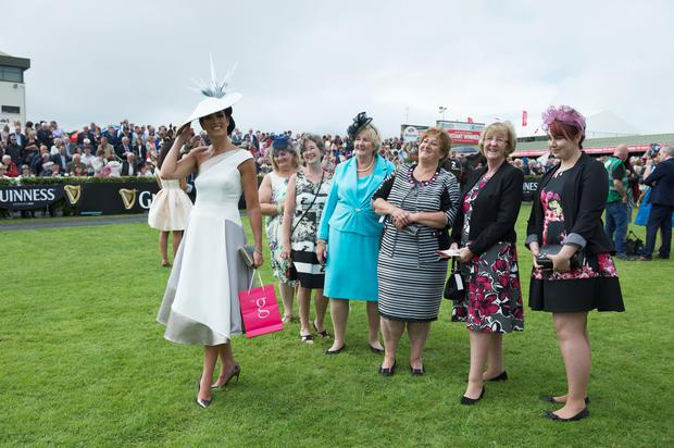 Lisa McGowan from Tullamore Co Offaly winner of the prestigious g Hotel & Spa Best Dressed lady competition on Ladies day of The Galway Races with some revellers