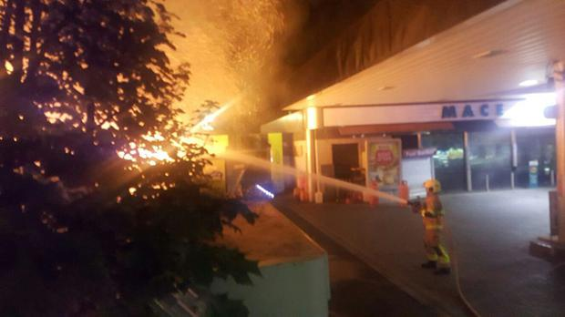 Firefighters battle the blaze at the derelict building, just yards from a petrol station.