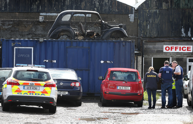 Gardai at the scene of the shooting on the Greenhills Road. Photo: Steve Humphreys