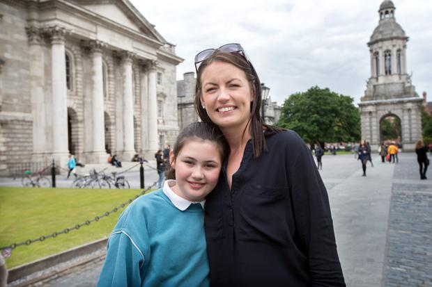 Erica Fleming who has been accepted into Trinity College with her 9 year old daughter Emily.