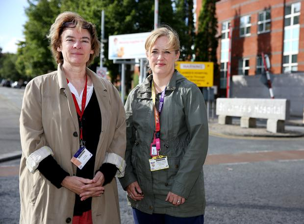Staff nurses Jo Tully and Cliona Byrne pictured outside the entrance to St James Hospital.