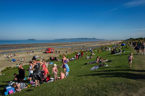 Families soak up the sun on Portmarnock Beach