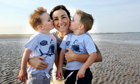 Rachel Lee pictured with her sons Lex and Bruce on Portmarnock beach. Picture; Gerry Mooney