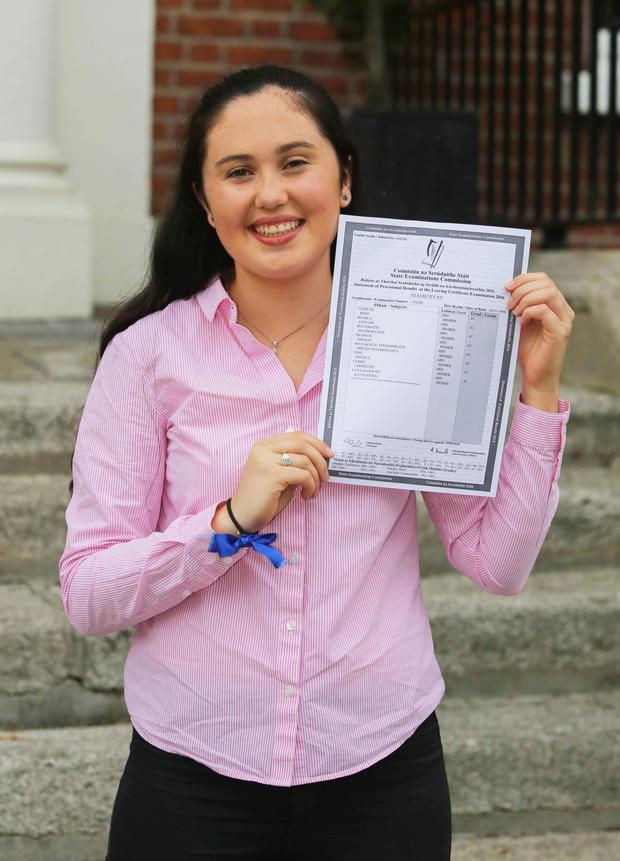 Niamh Ryan with her prized Leaving Certificate results. Photo: Gareth Chaney/Copyright Collins Photo Agency