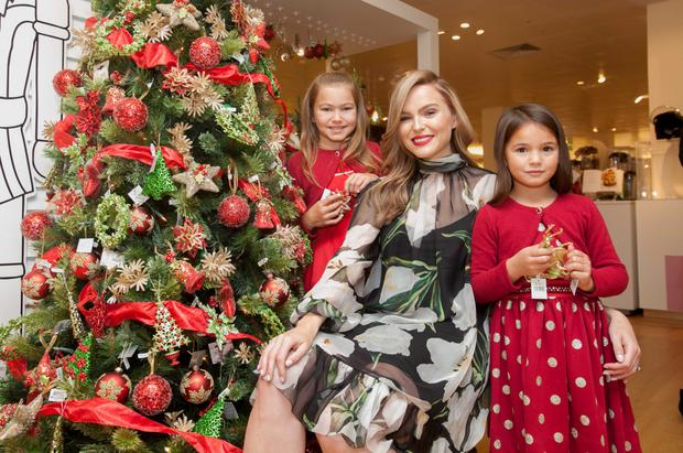 Sarah Morrissey with (L to R) Chloe Collins (8) from Castleknock & Aimee Deering (6) from Kildare at the unveling of Brown Thomas's Christmas Market at its store on Grafton Street, Dublin
