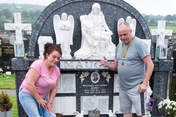 Helen Maughan and her husband Joe beside the desecrated grave of their son Bobby