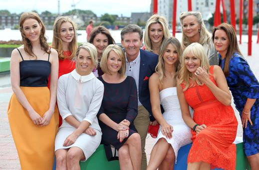 Daniel O'Donnell photobombs the RTE ladies, back from left, Louise O'Neill, Seana Kerslake, Daraine Mulvihill, Jenny Dixon, Dr. Eva, Dr. Ciara Kelly. Front row from left, Kathryn Thomas, Claire Byrne, Vogue Williams and Miriam O'Callaghan pictured this morning at the Bord Gais Theatre at the launch of the new season's shows for RTE 1 and RTE 2