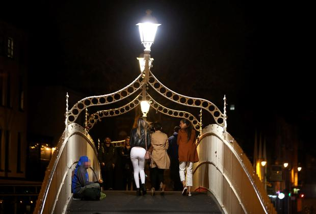 A homeless person braves the cold on Ha'penny Bridge (Stock picture)