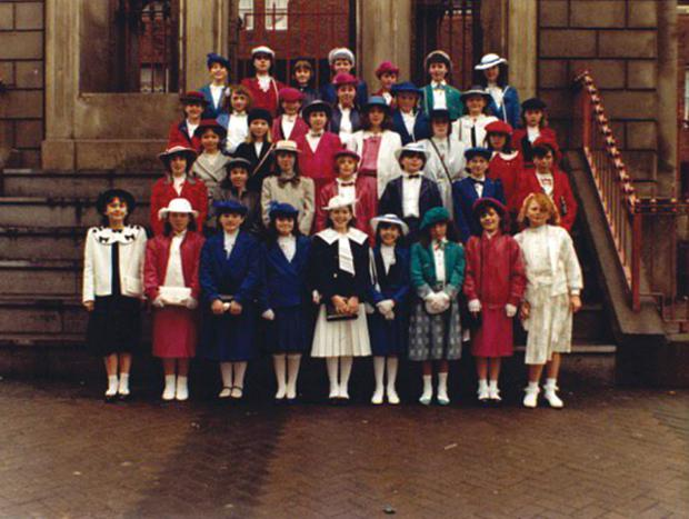 Circled, a young Imelda May (inset) making her Confirmation at St Brigid's in The Coombe in 1986